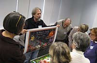Steve Buchanan showing his stamp images at a joint meeting of the New York and New England chapters.