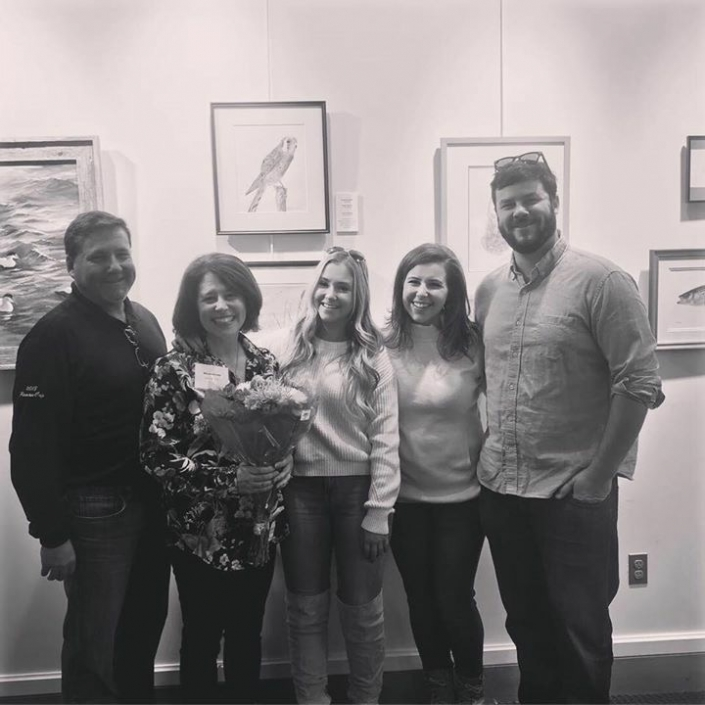 Wendy Berube celebrating her first exhibit with her family