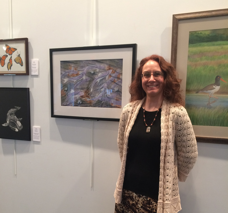 Wendy Chadbourne and her watercolor of blueback river herring.